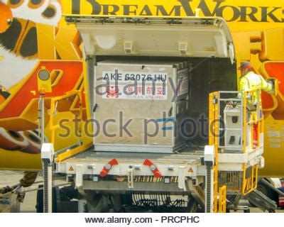 cargo and air freight loaded on pallet into an airliner at stock photo 1721204 alamy