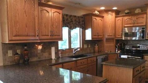 quartz countertops with oak cabinets pictures of oak cabinets with quartz countertops