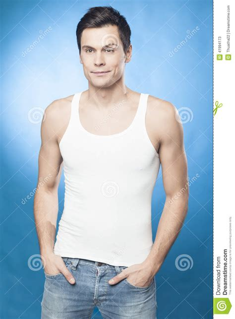 best stock photos of photo handsome man showing cell phone black handsome man in white tank top stock photo image 41994173