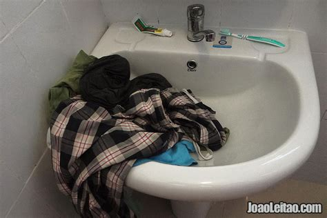 washing clothes in the bathtub how to do laundry while traveling step by step tips