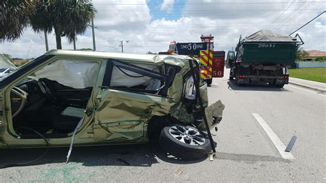 kia soul truck driver trapped in kia soul after collision with dump truck