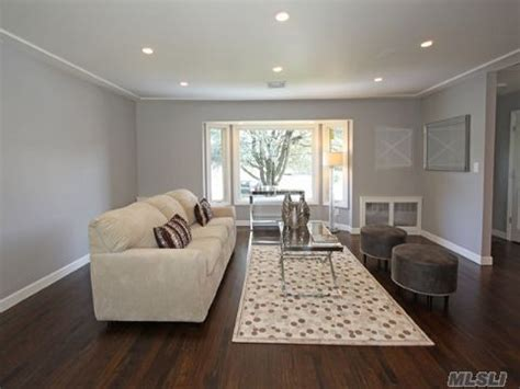 3 walls this color of light grey and one wall grey living room walls flooring trim