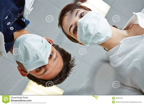 dentist and dental assistant looking at patient stock images image 33264754