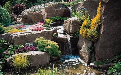 Large Backyard Landscape Design With Low Stone Waterfall Rocks For The Garden
