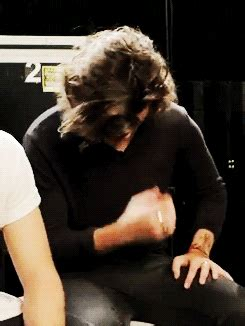 harry styles running his fingers through his hair long hair gif find share on giphy