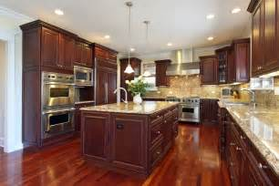 The rich red brown gleam of this kitchens cherry wood floors and red