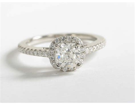 cushion cut halo engagement ring in 18k white gold