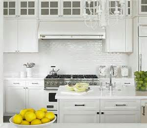 white kitchen white backsplash mini white subway tile backsplash white shaker kitchen cabinets marble countertops kitchen