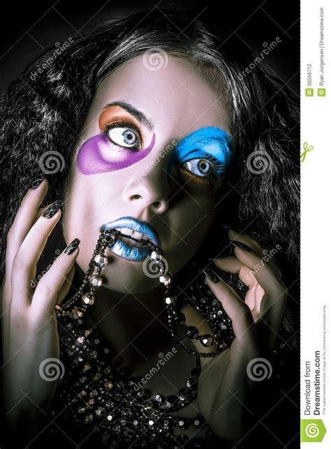 alternative fashion model face bright makeup stock photo
