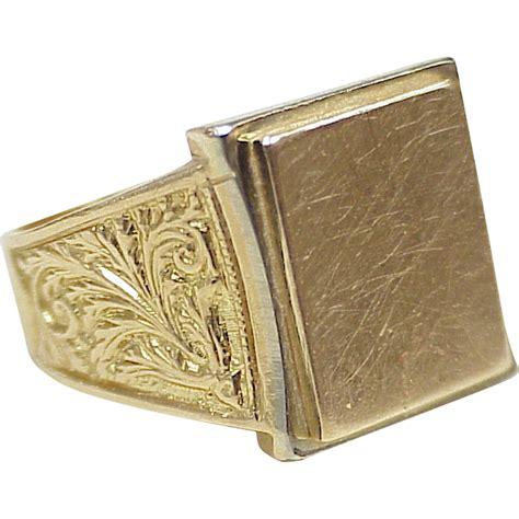 handsome signet ring 18k gold ornate embossed design from