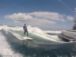 speed boat surfing video shows new zealand surfer coast along endlessly