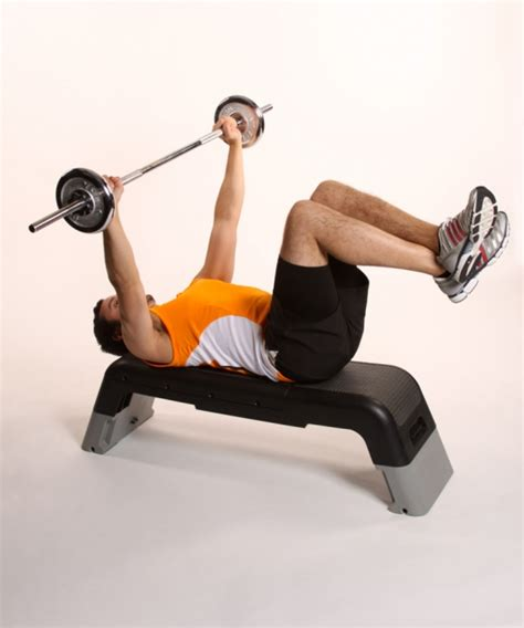 bench press with feet up bench press with barbell ibodz online personal trainer