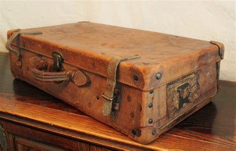 antique well traveled leather suitcase