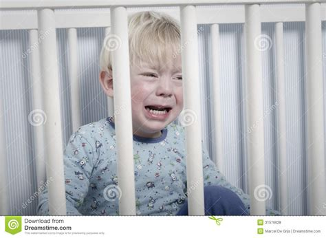 crying in bed crying boy in bed royalty free stock photos image 31576628