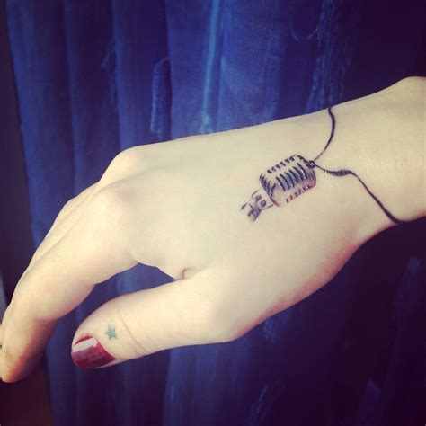 microphone tattoo thumb best 25 mic tattoo ideas on pinterest tiny tattoo