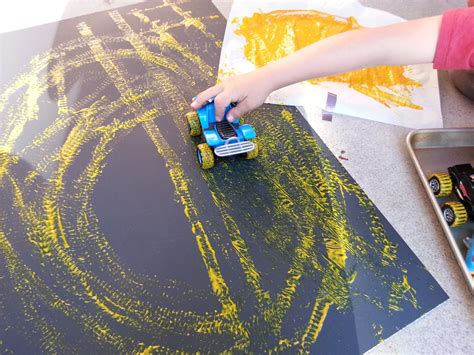 with paint choices for children painting with cars
