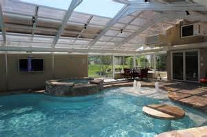 indoor and outdoor pool indoor outdoor living traditional pool chicago by rosebrook pools inc
