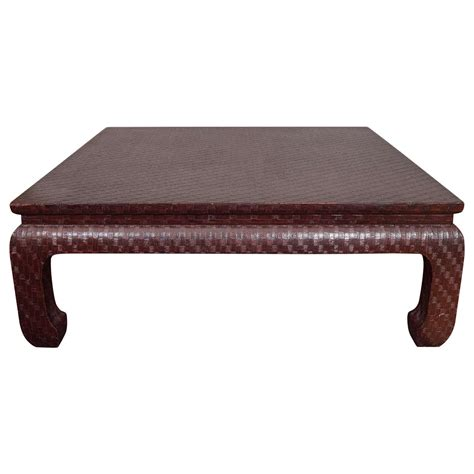 karl springer style burgundy grasscloth coffee table by