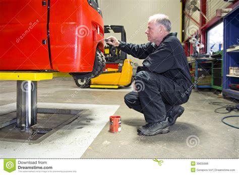 Forklift Technician by Forklift Paint Stock Photo Image Of Senior Roller 39635988