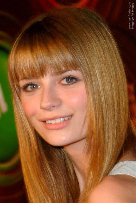 actress with long tapered face mischa barton wearing her hair long and tapered around her