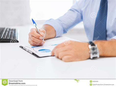 Signing Bonus Top Mba Schools by Businessman Working And Signing Papers Stock Image Image
