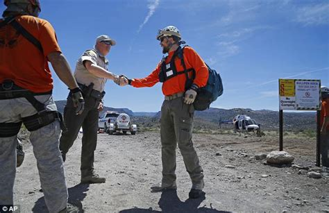 grandfather hiking with boy scouts rescued from in