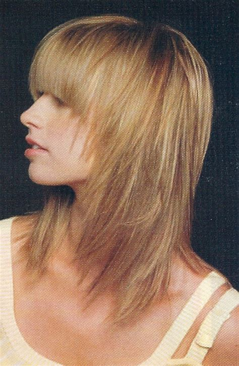what kind of medium haircut is appropriate for a 52 yr old women layered hairstyles for medium length hair side view of