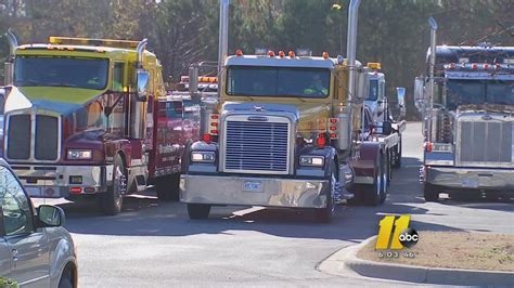 tow truck drivers gather to say goodbye to one of their