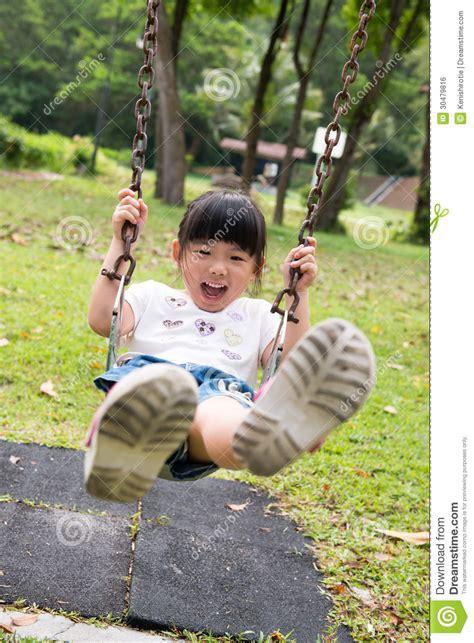 kid on swing kid on swing royalty free stock image image 30479816