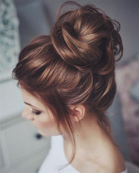 elegant knot hairstyles picture of messy hair top knot for a wedding