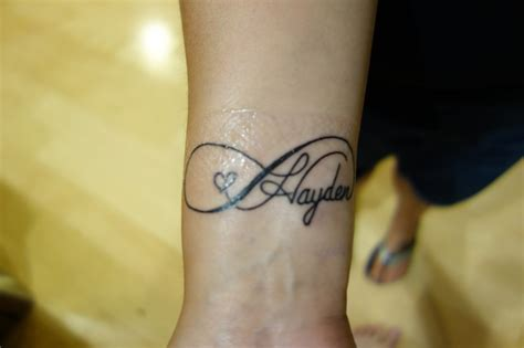 child name tattoos on wrist 35 graceful name tattoos for your wrist