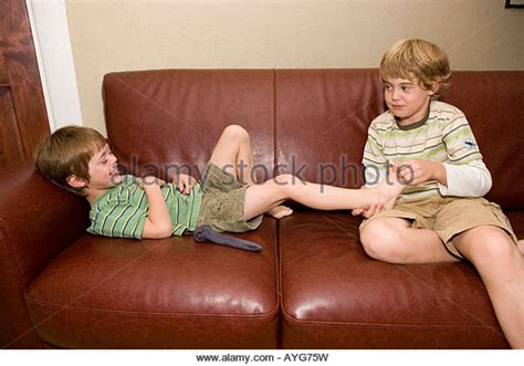 ticklish challenge tickle laughing laughter stock photos tickle laughing