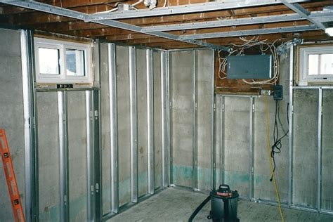 stud walls in basement framing with metal studs thumb and hammer