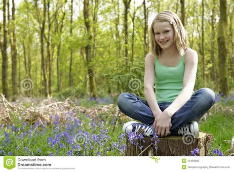 0008288607 the girl in the woods girl in woods stock photo image 12459880