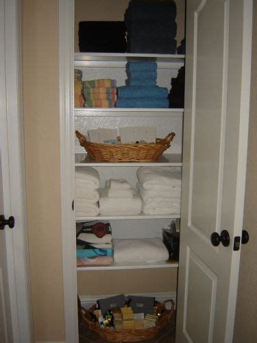 shallow linen closet organization storage ideas pinterest this is about how narrow our closets are i love the idea