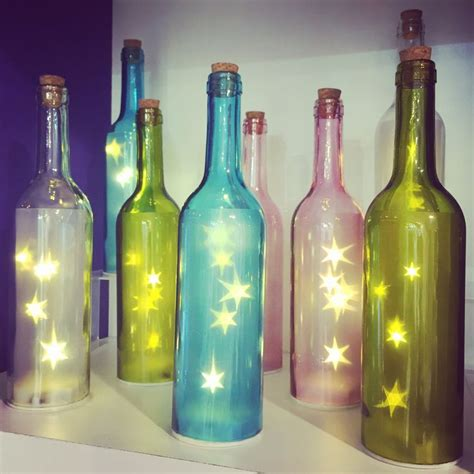 wine bottles with lights inside coloured glass bottle with star fairy lights inside