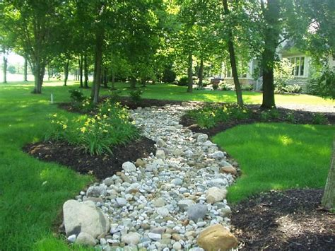 dry river bed landscaping dry creek bed for drainage how my garden grows pinterest