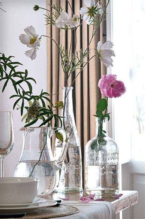 decorar interiores con flores decora con botellas de cristal y flores decoraci 243 n de