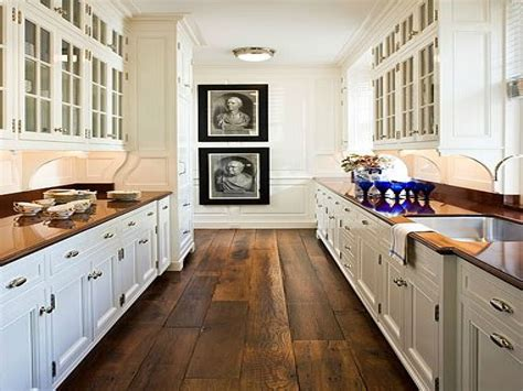 galley kitchen ideas galley kitchen wood floors white cabinets glass above
