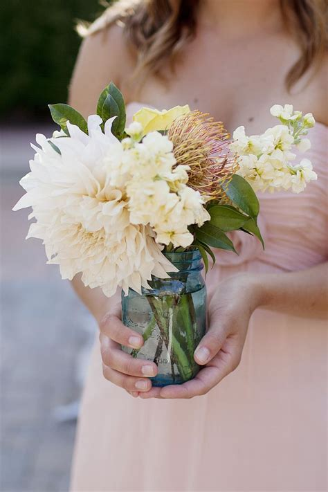 blue mason jar centerpiece, blush dahlia, yellow