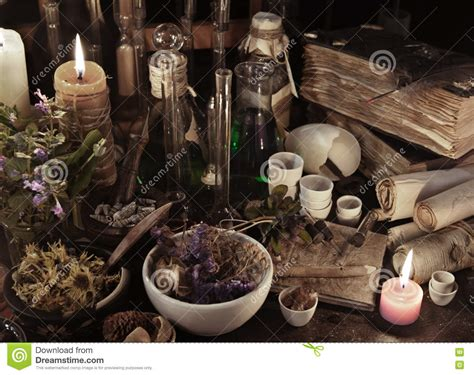 still life with witch books scrolls herbs and magic