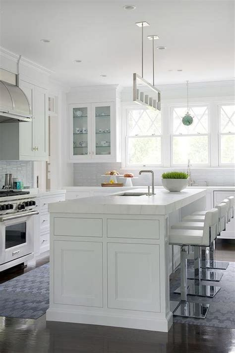 white kitchen island  thick marble countertop  white leather stools contemporary kitchen
