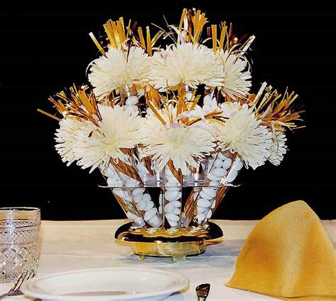 wanderful centerpieces and favors gold and ivory
