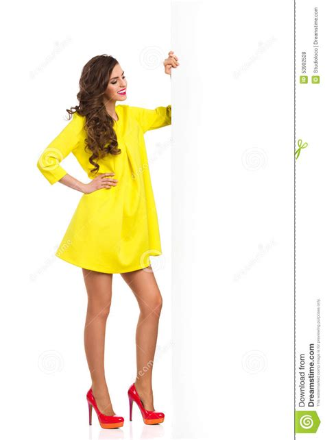 Dress Model Style Impor Yellow Purple Pink fashion model posing with big white banner stock photo image 53902528