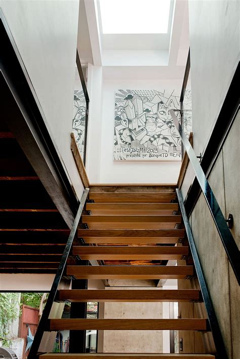 expansive quebec residence charms with inviting warmth of wood wall art adds a hint of playful charm to the staircase