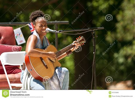who is the singer playing guitar in the direct tv commercial may 2016 female singer plays guitar and sings at festival editorial