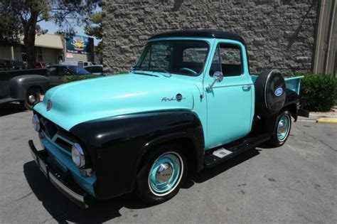 black and teal car seller of classic cars 1955 ford f 100 teal and black