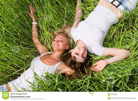 Lay On The by Two Lay On Green Grass Outdoors Stock Photo