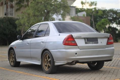Mobil Mitsubishi Lancer Evo 4 301 moved permanently