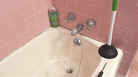 clogged bathtub with standing water how to unclog a bathtub drain with hair home design